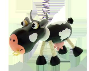 Dřevěná létající zvířátka na pružině Greenkid. Dřevěná kravička - hračka a dekorace do dětského pokoje od českého výrobce Abafactory.